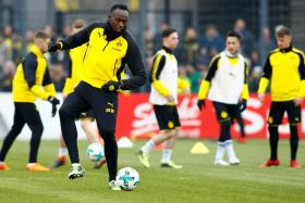 Usain Bolt training with the Borussia Dortmund team on Friday.