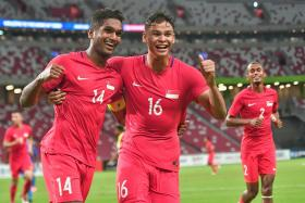 Singapore captain Hariss Harun (No. 14) celebrating with Irfan Fandi after scoring the first goal.