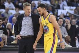 Golden State Warriors star Stephen Curry (right) will be re-evaluated in three weeks,  right around when the NBA play-offs are scheduled to begin on April 14.