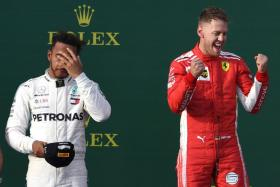 Ferrari's Sebastian Vettel (right) celebrates on the podium as Lewis Hamilton ponders a return to the drawing board for Mercedes.