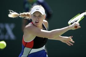 Caroline Wozniacki (above) had won the first set against Monica Puig 6-0, but then lost the next two 6-4 6-4 amid alleged verbal abuse from fans at the Miami Open.