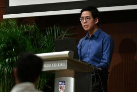 Mr Tan Yang Long giving his speech at the Tembusu Forum on Tuesday.