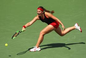 Jelena Ostapenko stretches to play a forehand against Elina Svitolina of Ukraine in the Miami Open quarter-finals.