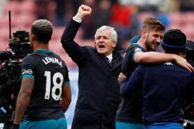 Southampton manager Mark Hughes (centre) celebrates after the Saints defeated Wigan in the FA Cup quarter-finals earlier this month.