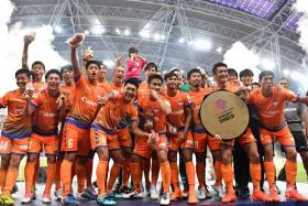 Albirex Niigata celebrating with their Great Eastern Community Shield.