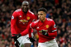 Manchester United's Alexis Sanchez celebrating with Romelu Lukaku after scoring the second goal.