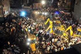 10 dead as building struck by car collapses in India