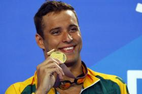 Chad le Clos with his gold medal in the men's 50m freestyle.