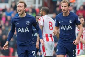 Christian Eriksen (left) celebrating with Harry Kane after scoring Tottenham's first goal against Stoke.