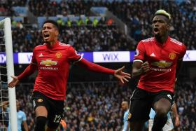 Manchester United's Chris Smalling (left) celebrating with Paul Pogba after scoring their third goal.