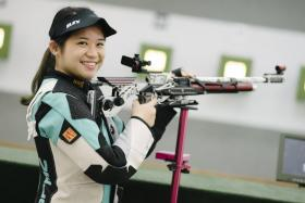 Singapore's Martina Veloso (above) showed nerves of steel to shoot a 10.3 in the sudden death play-off, pipping India's Mehuli Ghosh who shot a 9.9.