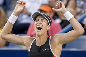 Muguruza wins first title of the year