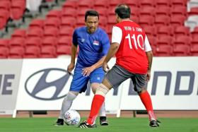 Singapore legend Fandi Ahmad (left) in action during an exhibition game.