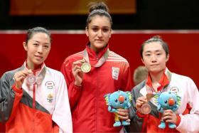 (From left) Singapore's Yu Mengyu (silver), India's Manika Batra (gold) and Singapore's Feng Tianwei (bronze) after the medal presentation for the Commonwealth Games women's singles event in table tennis.