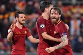 (From left) AS Roma's Alessandro Florenzi, Kevin Strootman and Daniele de Rossi celebrating their 3-0 win over Barcelona in the Champions League quarter-final, second leg.