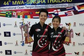 Singapore bowlers Shayna Ng (left) and Bernice Lim making it a one-two finish at the 44th MWA-Singha Thailand International Open on Saturday.