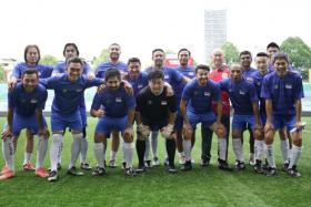The Singapore Veterans taking part in an exhibition match against Admiralty CSC at the Jalan Besar Stadium as part of the Singapore Heritage Festival.