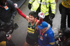 Japanese clerk calls work for day off after winning Boston Marathon