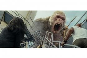 (From left) Naomie Harris as Dr Kate Caldwell and Dwayne Johnson as Davis Okoye face off with George in Rampage.