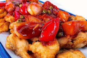 Fried fish with spicy sweet and sour sauce