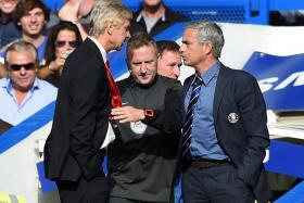 Arsenal manager Arsene Wenger (left) and Jose Mourinho, then in charge of Chelsea, clashing during an EPL match in 2014.
