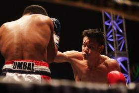 Muhamad Ridhwan (right) defeating Jebson Umbal of the Philippines in the IBO intercontinental featherweight title fight at the Singapore Indoor Stadium.