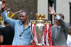 Patrick Vieira (left) with Arsene Wenger during an open-top bus parade after winning the EPL title in 2004.