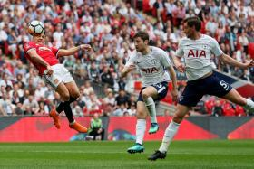 Alexis Sanchez heading in the equaliser for Manchester United.