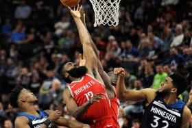 Harden sizzles as Rockets down Timberwolves