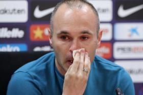 Andres Iniesta turning emotional during a press conference where he announced his decision to leave Barcelona.