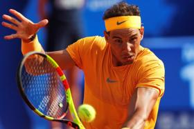 Rafael Nadal (above) is still some way behind all-time leader Guillermo Vilas of Argentina, who won 659 clay-court matches.