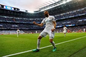 Real Madrid striker Karim Benzema celebrating after scoring their first goal.