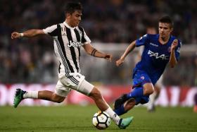 Juventus' Paulo Dybala making his way towards the Bologna goal.