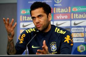 Dani Alves (above) could be replaced by Manchester City's Danilo or Corinthians' Fagner at right-back.