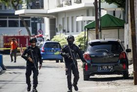 Militant family uses child in suicide bomb attack on Indonesian cops