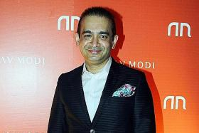 Indian police charge billionaire jeweller over bank fraud