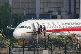 Sichuan Airlines co-pilot sucked halfway out of window, captain says