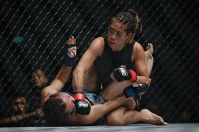 ONE Championship women's atomweight champion Angela Lee (top) retained her title after defeating Mei Yamaguchi.