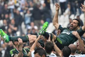 Gianluigi Buffon gets a lift from his teammates after his final match for Juventus.