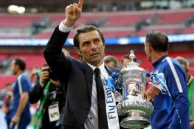 Chelsea manager Antonio Conte celebrates with the FA Cup trophy after a 1-0 win over Manchester United.
