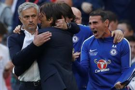 Manchester United manager Jose Mourinho (left) congratulating Chelsea boss Antonio Conte after the Blues won the FA Cup final.