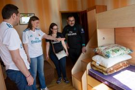 Ukraine's Information minister Yuriy Stets (far left) and his wife Yana Konotop, a Ukrainian TV presenter, welcoming Real Madrid supporters from Luxembourg, Julie Pierson and her companion Jorge Ramirez.