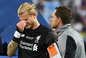Liverpool goalkeeper Loris Karius in tears after the game.