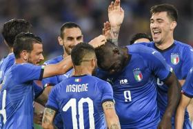 Mario Balotelli (No. 9) gets feted by his teammates after scoring for Italy.