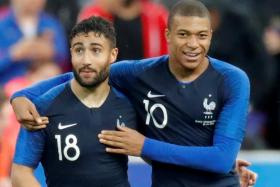 France's Nabil Fekir (left) celebrating with Kylian Mbappe after scoring in their 2-0 win over Ireland.