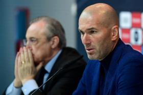 Real Madrid's French coach Zinedine Zidane, sitting beside president Florentino Perez, during a press conference to announce his resignation in Madrid on May 31, 2018.