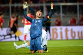 Germany goalkeeper Manuel Neuer reacts after conceding the second goal.