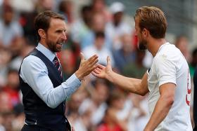 England manager Gareth Southgate shaking hands with Harry Kane after their friendly win over Nigeria.