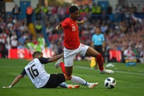 England's striker Marcus Rashford (R) vies with Costa Rica's defender Cristian Gamboa (L).