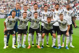 Germany's starting XI against Saudi Arabia: (front row, L-R): Joshua Kimmich, Marco Reus, Julian Draxler, Thomas Mueller and Timo Werner, (back row, L-R): Manuel Neuer, Toni Kroos, Mats Hummels, Jonas Hector, Sami Khedira and Jerome Boateng.